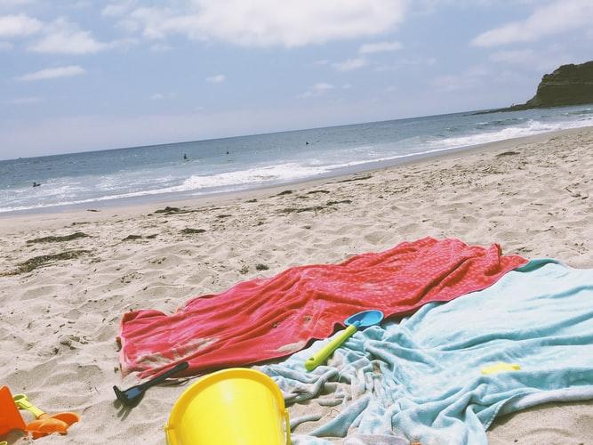 Tipi di teli mare: come lavarli nel modo giusto